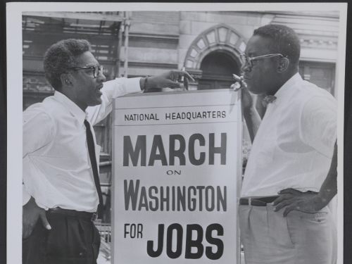 Two men holding March on Washington sign