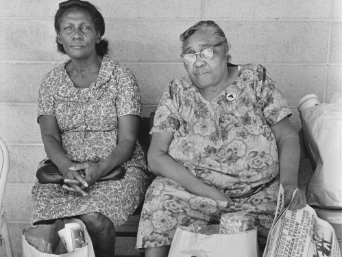 Two women with bags of food
