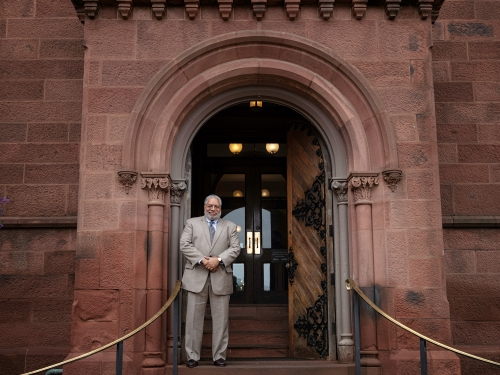 Lonnie Bunch stands at east door of Castle