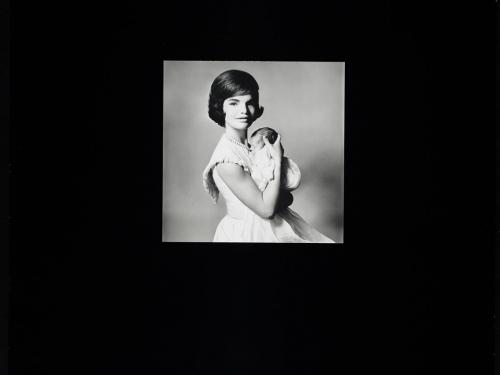 Black and White photo of Jacqueline Kennedy holding infant John