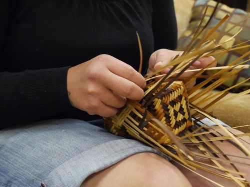 Close up of hands of basket weaver