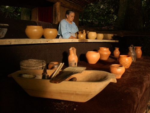 A potter with traditional Cherokee pottery
