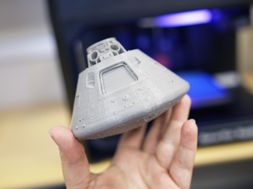 small gray model of command module