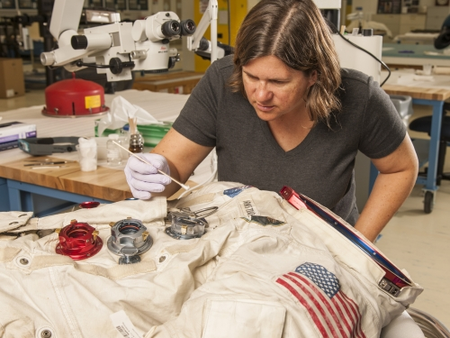 Conservator working on spacesuit