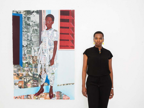 Artist posing with one of her paintings