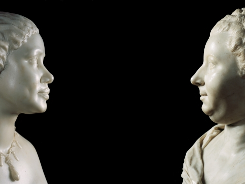 Two busts facing each other