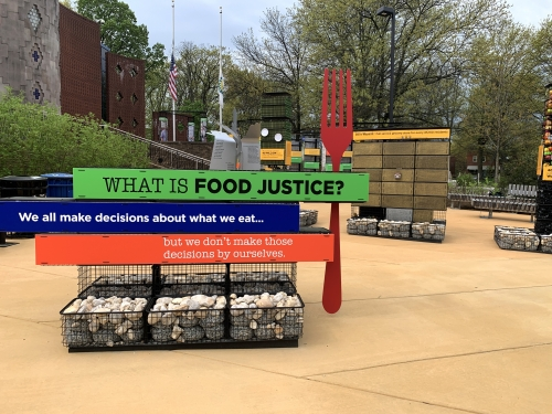 """What is Food Justice?"" signage outdoors"