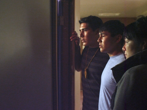 Movie Still of three young people in profile