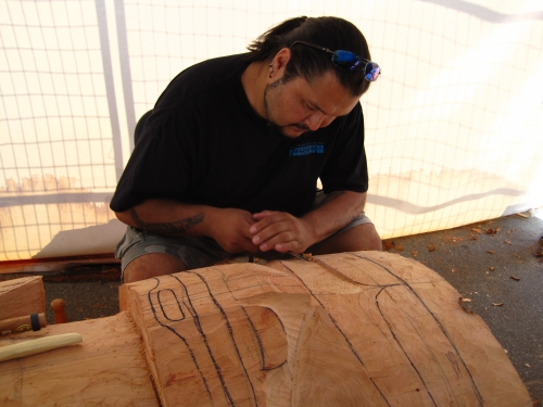 Mike Dangeli carving a mask