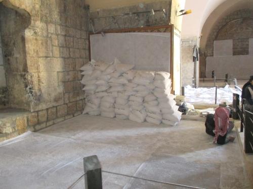 Sandbags protecting mosaics