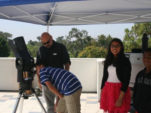 Kids using telescope