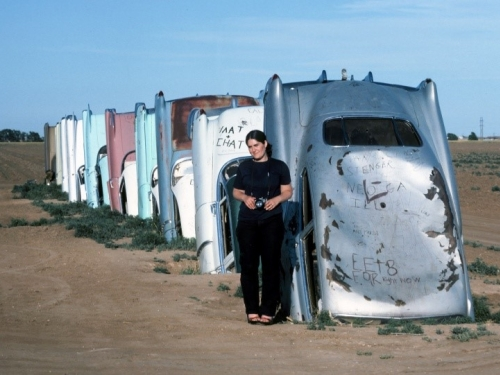 Jane Stern at Cadillac Ranch (hald buried cars)