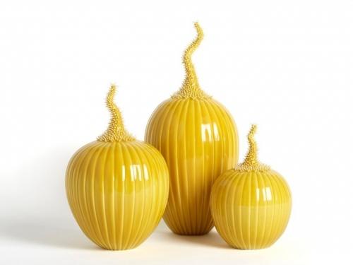 Three yellow vases