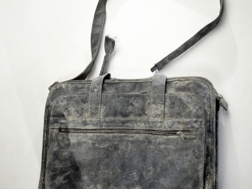 Battered black bag with shoulder strap
