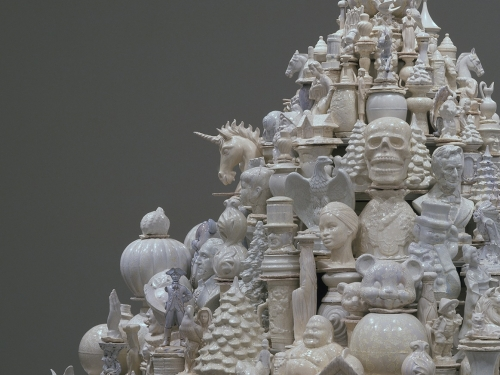 Close up of sculpture comprised of porcelain objects