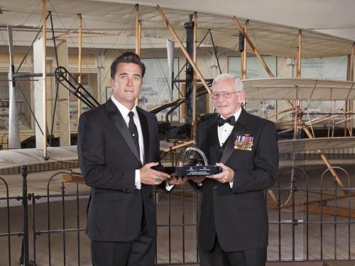 Dr. Adam Steltzner, trophy winner, with museum director Jack Dailey