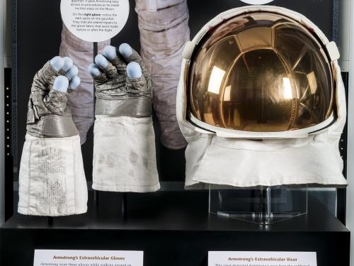 Exhibit display of gloves and helmet