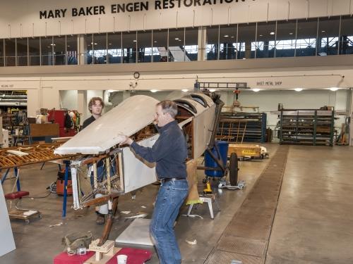 Conservators work on airplane