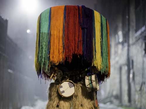 Person completely obscured by colorful headdress