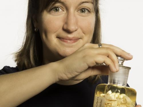 woman holding jar of parasites