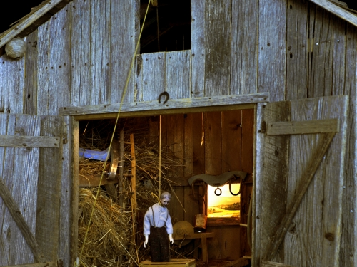 Model of man hanging in barn