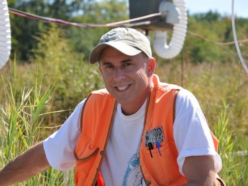 man in orange vest