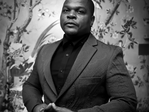 Black and white portrait of artist Kehinde Wiley
