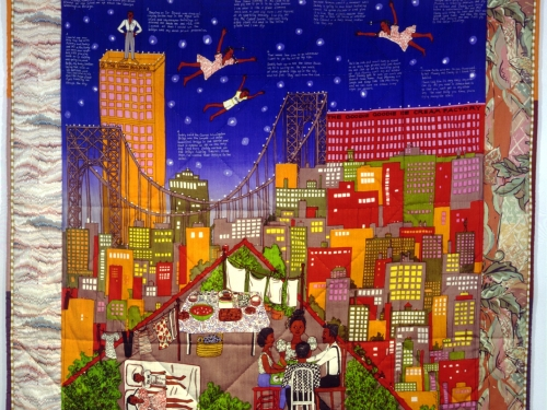Colorful quilt featuring city skyline