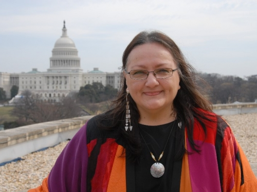 Harjo standing on the national Mall
