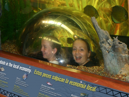 girls smiling under plastic dome