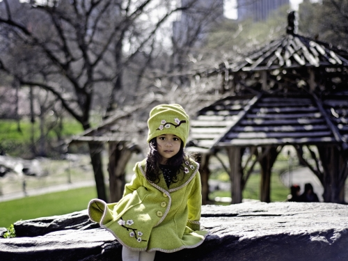 woman modeling green coat