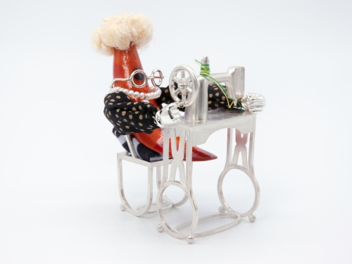 whimsical carrot at sewing machine