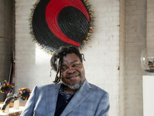 Portrait of artist Yinka Shonibare in studio