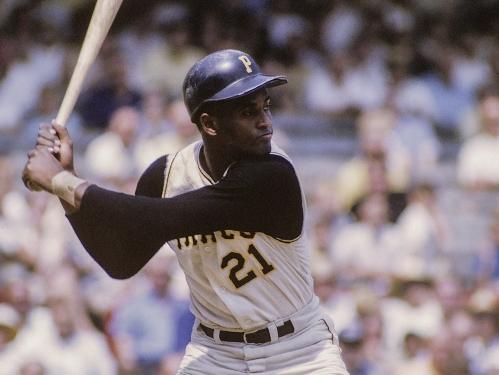 Baseball player swinging a baseball bat at a game