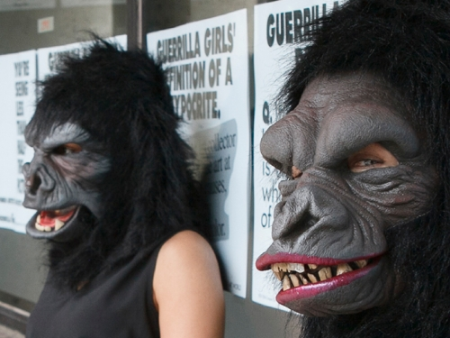 Talking To Our Time graphic with image of three women dressed in gorilla masks