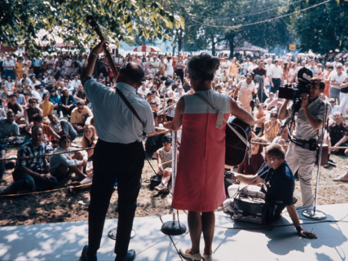 Two performers at 1968 festival with back to camera