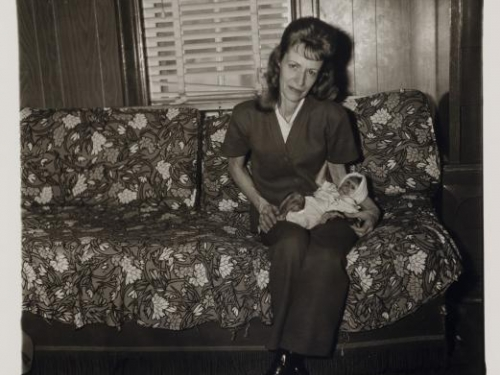Arbus photo of woman with baby monkey