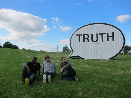 Truth Booth in a field of grass