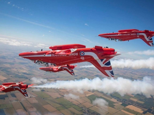 red planes flying upside down