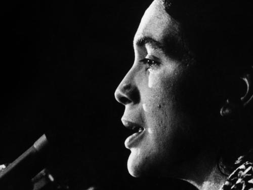 Dolores Huerta speaks into microphone