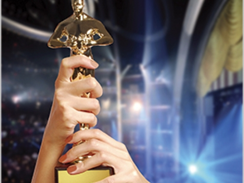 Hands holding Academy Award