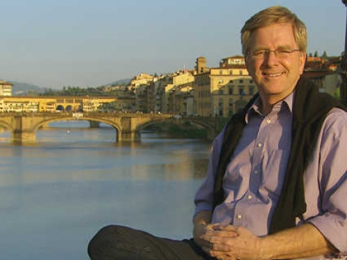 Rick Steves against backdrop of canal in FLorence