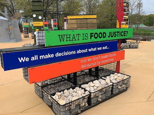 "Outdoor sign display with text ""What is food justice?"""