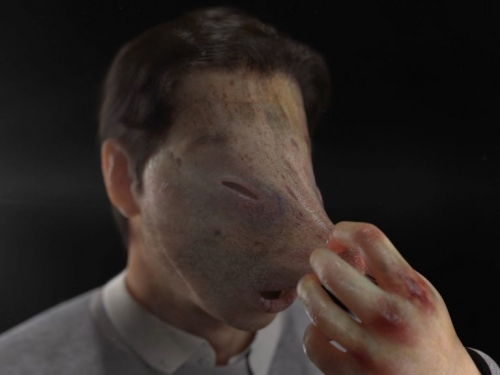 artwork showing man with plastic face