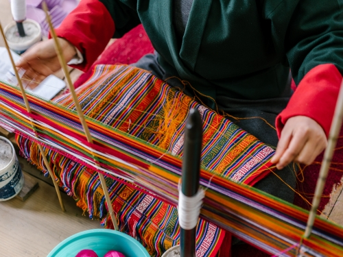 Close up of Bhutan weaver at work