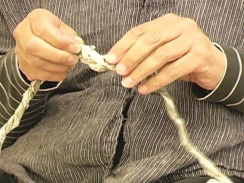 Close up of hands holding rope