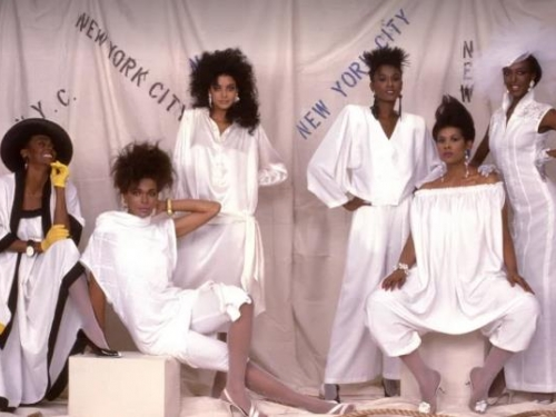 black fashion models posing against backdrop