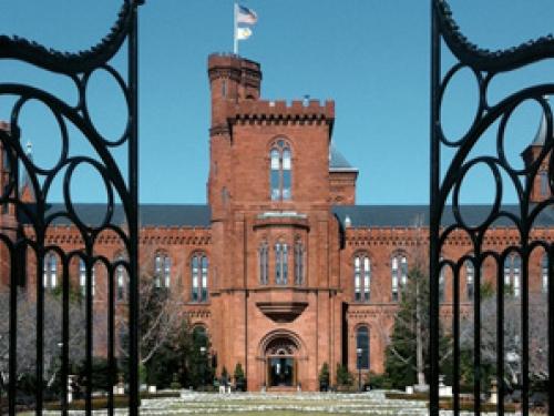 Smithsonian Castle seen through iron gates