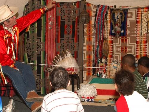 Children listening to older Native American man