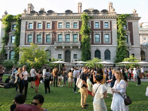 People on lawn in front of Cooper Hewitt